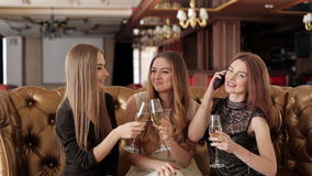 Three young girls at the party drinking champagne and talking. stock footage