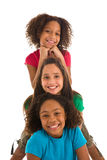 Three young girls in a row Stock Images