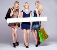 Three young girls shopping. Stock Photo