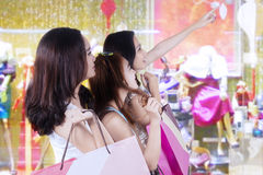 Three young girls shopping together Stock Photo