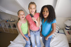 Three Young Girls Standing On A Bed royalty free stock photos