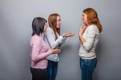 Three young girls talking and European appearance Royalty Free Stock Images