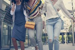 Three young girls walking happy with shopping bags. Fun in city stock photos