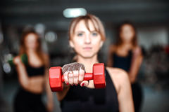 Three young girls workout in the gym Royalty Free Stock Photography