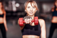 Three young girls workout in the gym Stock Images