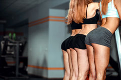 Three young girls workout in the gym Stock Photos