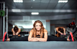 Three young girls workout in the gym Royalty Free Stock Images