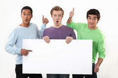 Three young guys with sign Stock Image