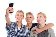 Three young guys taking self Stock Images