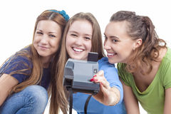 Three Young Happy caucasian Females With Photocamera Taking Self Stock Image