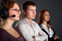 Three young happy and successful businesspeople Royalty Free Stock Images