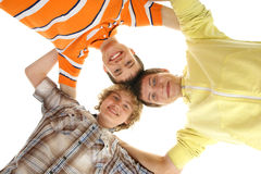 Three young and happy teenagers holding together Royalty Free Stock Image