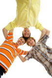 Three young and happy teenagers holding together Stock Images