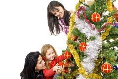 Three young happy women decorating Stock Images