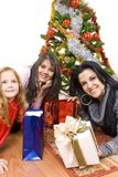 Three young happy womenwhit gift box Stock Photography