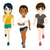 Teenager Boys Jogging. Three young jogging diverse teenager boys exercising running sport Royalty Free Stock Photos