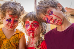 Three young kids with painted faces, child zomb. Three young kids - boy and girl - with painted faces, child zombie face art Royalty Free Stock Photos