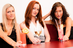 Three young ladies with a drinks Stock Images