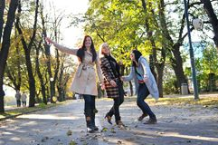 Three young ladies enjoying themselves royalty free stock photography