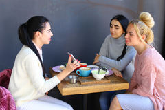 Three young magnificent girl girlfriends chatter, gossiping, sha Stock Images