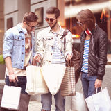 Three Young male fashion metraseksualy shop shopping walk Stock Photo
