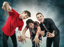 Three young man in fun hip hop poses Royalty Free Stock Photography