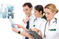 Three young medical workers in white clothes Stock Images
