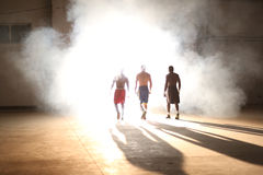 Three young men boxing workout in an old building.  royalty free stock photography