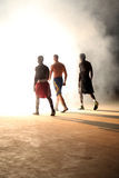 Three young men boxing workout in an old building.  royalty free stock images
