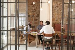Three young men at a meeting in a boardroom, close up Royalty Free Stock Photos