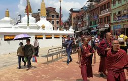 Monks at the Boudhanath temple complex in Kathmandu, the capital of Nepal stock photos