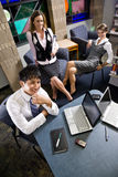 Three young office workers working in meeting room Royalty Free Stock Photo