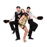 Three  young old-fashioned dancers. Dancing, isolated over white background Stock Image