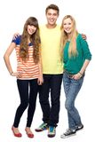 Three young people. Standing over white background Royalty Free Stock Photo