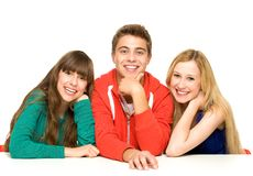 Three young people. Over white background Stock Photos