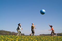 Three young people with ball Stock Photography