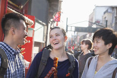 Three young people with candied haw. Stock Image