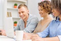 Three young people are collaborating in the office Royalty Free Stock Photo