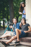 Three young people. Communicate with each other. Outdoors Royalty Free Stock Photography
