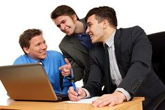 Three young people discussing Royalty Free Stock Images