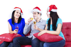 Three young people drink champagne Royalty Free Stock Photos