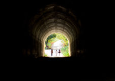 The three young people at the end of the tunnel Royalty Free Stock Photos
