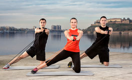 Three young people exercising Royalty Free Stock Images