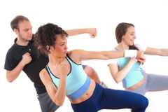 Three young people exercising together Royalty Free Stock Images