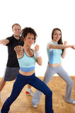 Three young people fitness training, punching stock photos