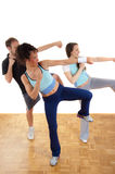 Three young people group fitness training. Three young people fitness exercising, kicking Royalty Free Stock Image