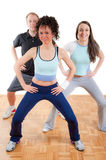 Three young people in the gym royalty free stock photo