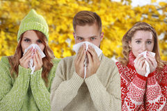 Three young people with handkerchief and pullover Royalty Free Stock Photos