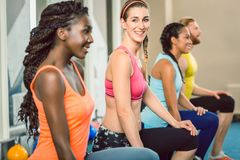 Three young people holding kettlebells during functional trainin Royalty Free Stock Image