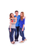 Three young people isolated on white background Royalty Free Stock Images